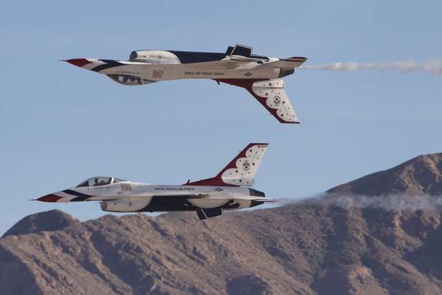 A pair of U.S. Air Force Thunderbirds aircrafts performs during the Aviation Nation air show at Nellis Air Force Base in Las Vegas Saturday, Nov. 8, 2014. (Erik Verduzco/Las Vegas Review-Journal)