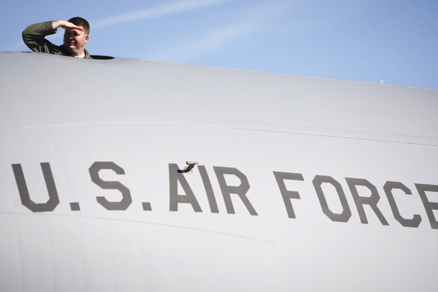U.S. Air Force 1st Lt. Justin Sager looks out from a cargo aircraft on display during the Aviation Nation air show at Nellis Air Force Base in Las Vegas Saturday, Nov. 8, 2014. (Erik Verduzco/Las  ...