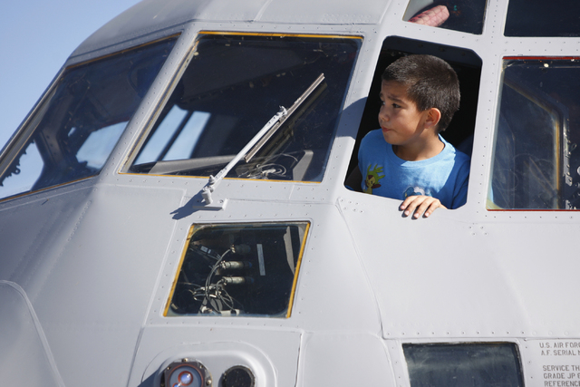 George Gutierrez, 8, looks out from an U.S. Air Force cargo aircraft on display during the Aviation Nation air show at Nellis Air Force Base in Las Vegas Saturday, Nov. 8, 2014. (Erik Verduzco/Las ...