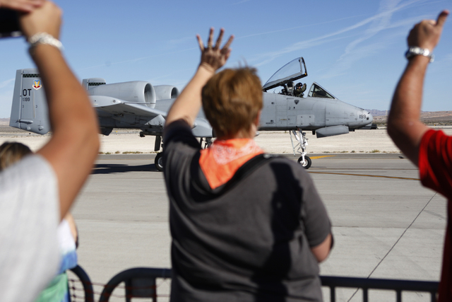 An aircraft pilot waves at spectators after performing during the Aviation Nation air show at Nellis Air Force Base in Las Vegas Saturday, Nov. 8, 2014. (Erik Verduzco/Las Vegas Review-Journal)