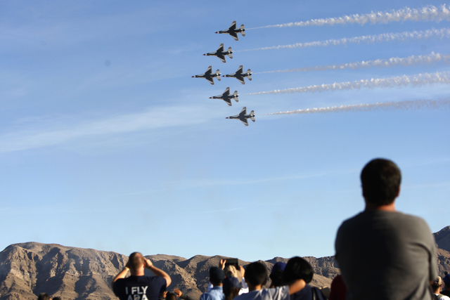 Spectators watch a performance by the U.S. Air Force Thunderbirds during the Aviation Nation air show at Nellis Air Force Base in Las Vegas Saturday, Nov. 8, 2014. (Erik Verduzco/Las Vegas Review- ...