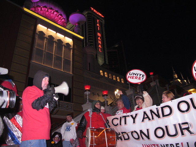 Union members march on the Atlantic City N.J. Boardwalk on Wednesday, Nov. 19, 2014, to protest the role of billionaire investor Carl Icahn in the planned closure of the Trump Taj Mahal Casino Res ...