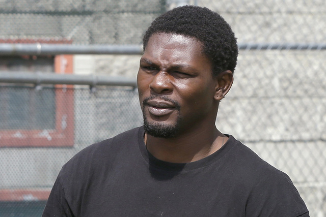 Boxer Jermain Taylor walks from the Pulaski County Jail in Little Rock, Ark., Wednesday, Aug. 27, 2014. Arkansas prosecutors have charged Taylor in a shooting at his home. (AP Photo/Danny Johnston)