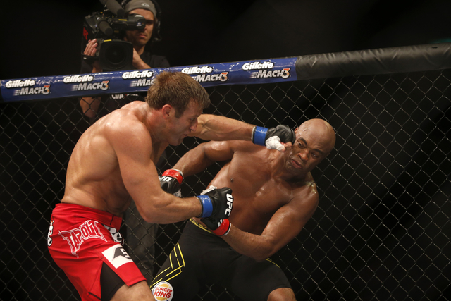 Anderson Silva, right, from Brazil, fights Stephan Bonnar, from the United States, during their light heavyweight mixed martial arts bout at the Ultimate Fighting Championship (UFC) 153 in Rio de  ...