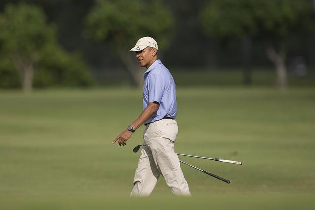 President Barack Obama walks to the second green at Kaneohe Klipper Golf Course on Marine Corps Base Hawaii, in Kaneohe Bay, Hawaii, Thursday, Jan. 2, 2014. (AP Photo/Carolyn Kaster)
