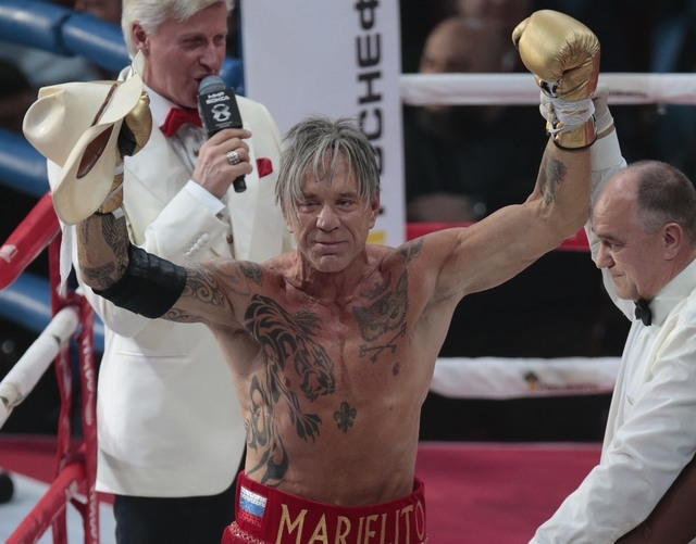 Mickey Rourke celebrates his victory against his opponent, Elliot Seymour of the United States, after their professional boxing match at the Luzhniki Stadium  in Moscow, Friday, Nov. 28, 2014. The ...