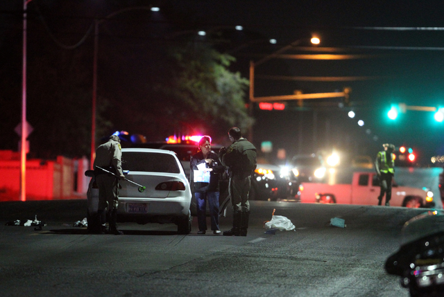 Las Vegas police investigate the scene of an auto-pedestrian crash on Washington Avenue east of Valley View Boulevard Monday, Nov. 3, 2014. A female pedestrian was struck in a marked crosswalk, an ...