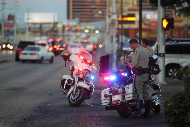 Las Vegas police investigate the scene where a pedestrian was struck by a vehicle near the intersection of Spring Mountain and Wynn roads Tuesday, Nov. 4, 2014. The injured man was transported to  ...