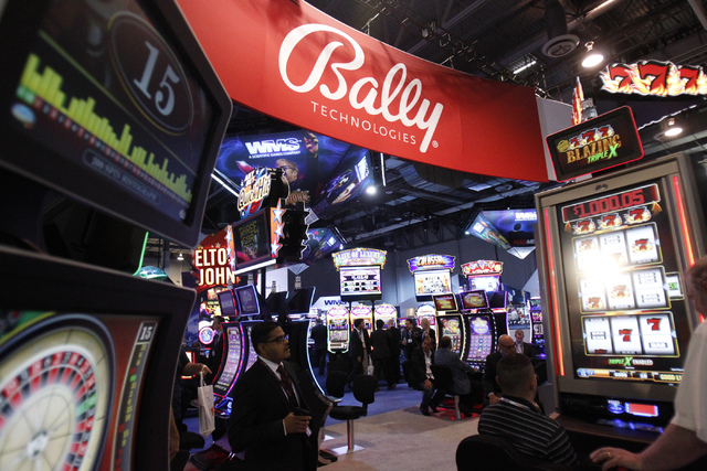 Bally Technologies' new slot machines are on display during the Global Gaming Expo at Sands Expo and Convention Center in Las Vegas, Sept. 30, 2014. On Tuesday, Nov. 18, Bally shareholders approve ...