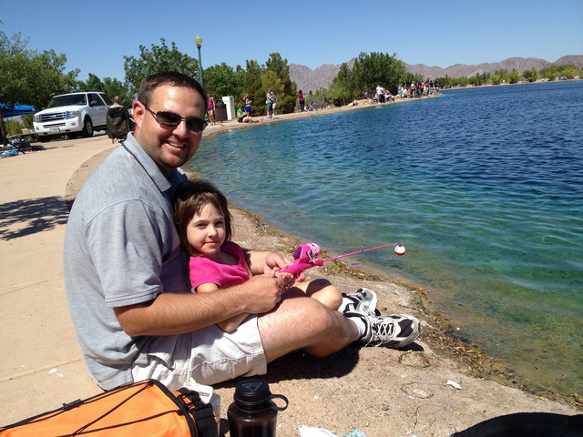 Steven Slivka/Boulder City Review William Atkinson and his daughter Amelia were among those visiting the pond at Veterans Memorial Park to participate in Free Fishing Day Saturday.