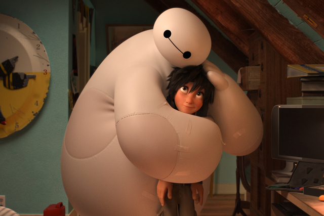 "Baymax (voiced by Scott Adsit) hugs Hiro (Ryan Potter) in a scene from ""Big Hero 6."" (Courtesy Disney)"