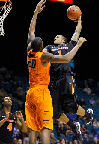 Oregon State's Gary Payton II (1) shoots against Oklahoma State's Michael Cobbins during the first half of a NCAA basketball game during the MGM Grand Main Event at the MGM Grand Garden Arena on M ...