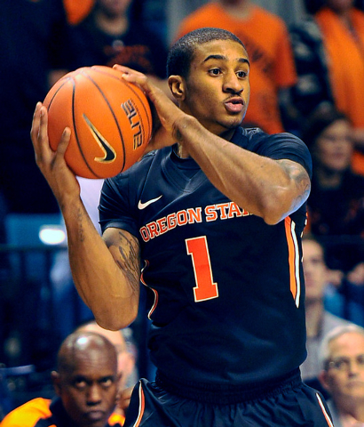 Oregon State's Gary Payton II looks to pass the ball against Oklahoma State during the first half of a NCAA basketball game during the MGM Grand Main Event at the MGM Grand Garden Arena on Monday, ...