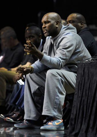 Former NBA player Gary Payton watches his son, Gary Payton II, play from court side during the MGM Grand Main Event at the MGM Grand Garden Arena on Monday, Nov. 24, 2014, in Las Vegas. (David Bec ...