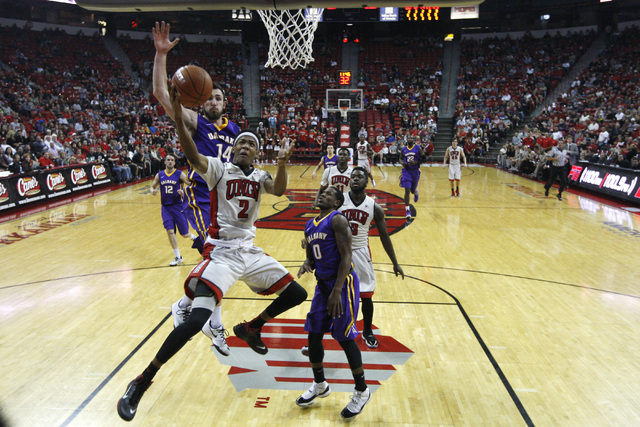 UNLV guard Patrick McCaw gets past Albany forward Sam Rowley for a basket during their game Saturday, Nov. 29, 2014 at the Thomas & Mack Center. (Sam Morris/Las Vegas Review-Journal)