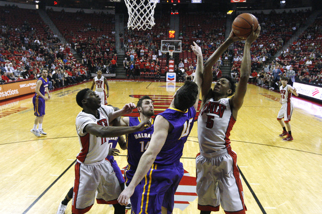 UNLV forward Christian Wood grabs a rebound from Albany forward Mike Rowley during their game Saturday, Nov. 29, 2014 at the Thomas & Mack Center. (Sam Morris/Las Vegas Review-Journal)