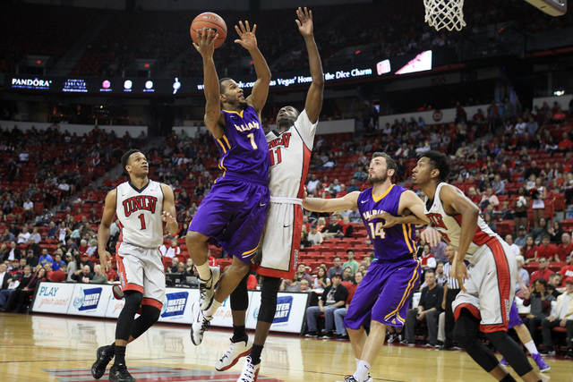 Albany guard/forward Ray Sanders is defended by UNLV forward Goodluck Okonoboh during their game Saturday, Nov. 29, 2014 at the Thomas & Mack Center. (Sam Morris/Las Vegas Review-Journal)