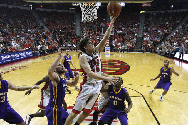 UNLV guard Cody Doolin lays in two points against Albany during their game Saturday, Nov. 29, 2014 at the Thomas & Mack Center. (Sam Morris/Las Vegas Review-Journal)