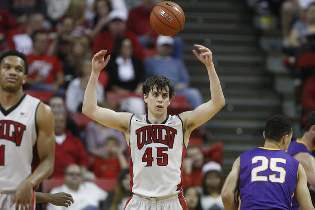 UNLV guard Cody Doolin throws the ball in frustration after committing a foul during their game against Albany Saturday, Nov. 29, 2014 at the Thomas & Mack Center. (Sam Morris/Las Vegas Review-Jou ...