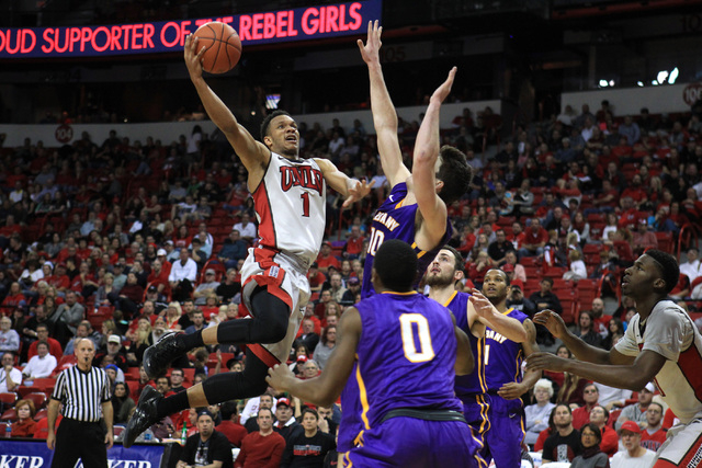 UNLV guard Rashad Vaughn drives to the basket while bend defended by Albany forward Mike Rowley during their game Saturday, Nov. 29, 2014 at the Thomas & Mack Center. Vaughn finished with a game h ...