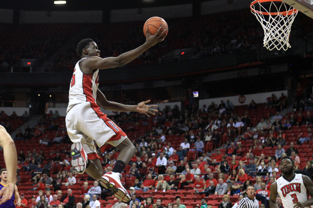 UNLV forward Dwayne Morgan drives in for an uncontested basket against Albany Saturday, Nov. 29, 2014 at the Thomas & Mack Center. (Sam Morris/Las Vegas Review-Journal)