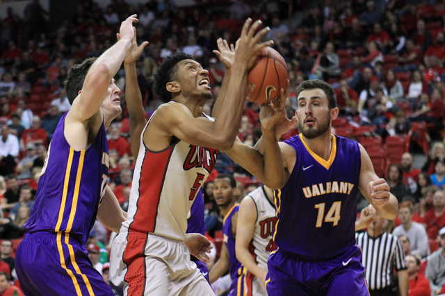 UNLV forward Christian Wood is defended by Albany forward Mike Rowley, left, and Albany forward Sam Rowley during their game Saturday, Nov. 29, 2014 at the Thomas & Mack Center. (Sam Morris/Las Ve ...