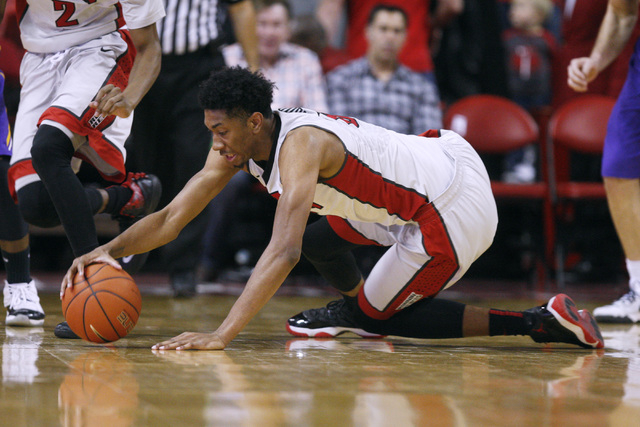 UNLV forward Christian Wood dives for a loose ball during their game against Albany Saturday, Nov. 29, 2014 at the Thomas & Mack Center. (Sam Morris/Las Vegas Review-Journal)