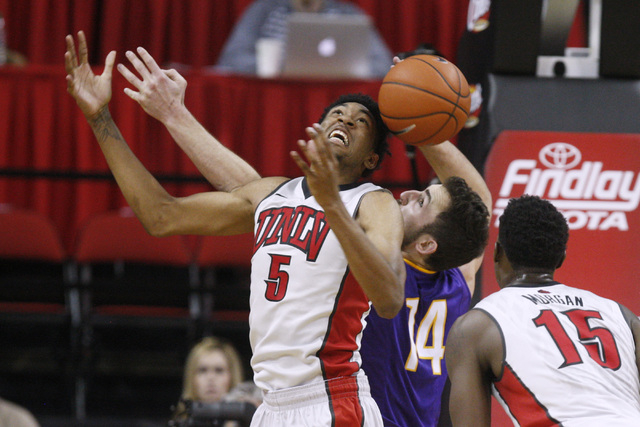 UNLV forward Christian Wood and Albany forward Sam Rowley try to locate a rebound during their game Saturday, Nov. 29, 2014 at the Thomas & Mack Center. (Sam Morris/Las Vegas Review-Journal)