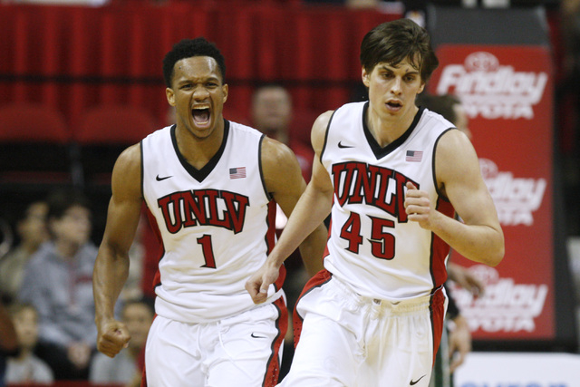 UNLV guard Rashad Vaughn yells after a dunk as he and Cody Doolin head back up court during the Rebels' exhibition game against Florida National University Wednesday, Nov. 5, 2014, at the Thomas & ...