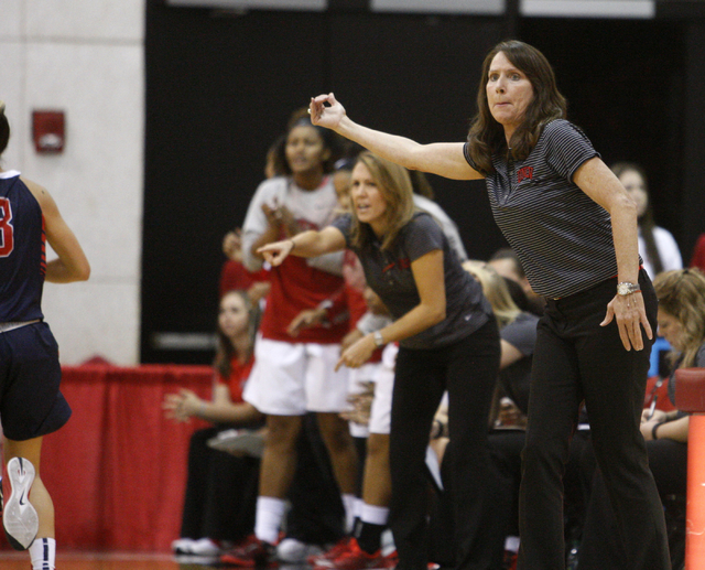 UNLV womenճ basketball coach Kathy Olivier gives instruction to her team as the Lady Rebels take on Dixie State in the first half of an exhibition game at the Cox Pavilion Monday, Nov. 10, 2 ...
