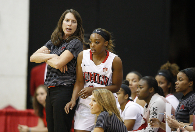 UNLV womenճ basketball coach Kathy Olivier, left, sends senior guard Briana Charles into the game as the Lady Rebels take on Dixie State in the first half of an exhibition game at the Cox Pa ...
