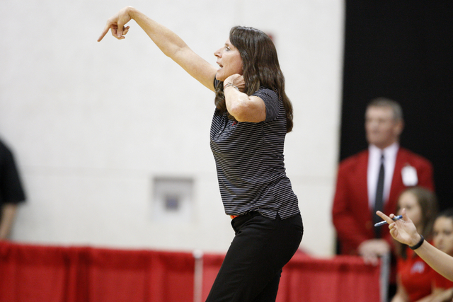 UNLV womenճ basketball coach Kathy Olivier gives instruction to her team as the Lady Rebels take on Dixie State in the first half of an exhibition game at the Cox Pavilion Monday, Nov. 10, 2014.  ...