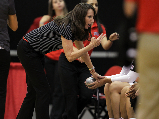 UNLV womenճ basketball coach Kathy Olivier gives instruction to her team before the Lady Rebels take on Dixie State in an exhibition game at the Cox Pavilion Monday, Nov. 10, 2014. (K.M. Can ...