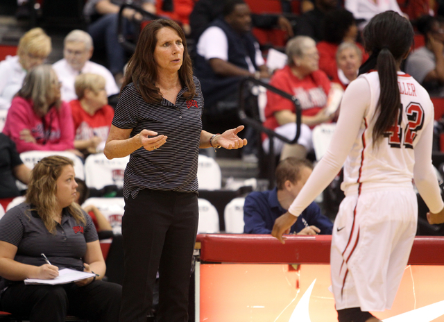 UNLV womenճ basketball coach Kathy Olivier gives instruction to senior guard Danielle Miller (42) as the Lady Rebels take on Dixie State in an exhibition game at the Cox Pavilion Monday, Nov ...