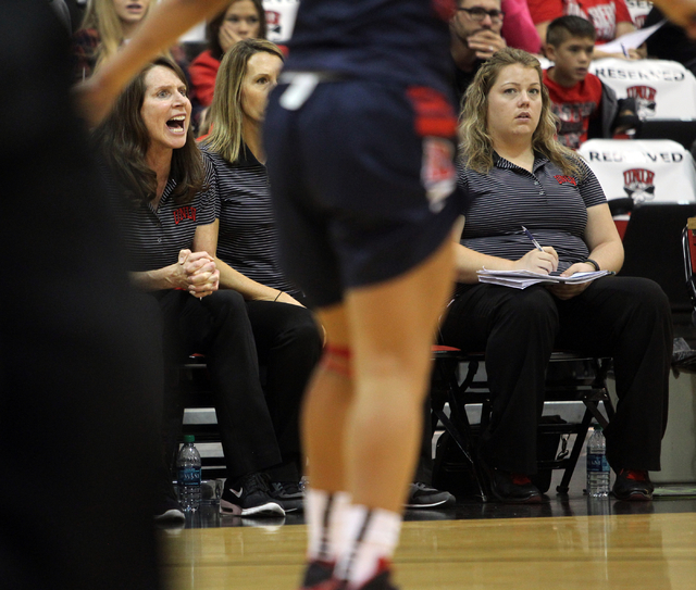 UNLV womenճ basketball coach Kathy Olivier, left, gives instruction to her team as the Lady Rebels take on Dixie State in the second half of an exhibition game at the Cox Pavilion Monday, No ...