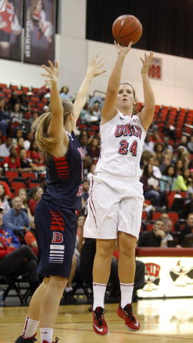 UNLV womenճ basketball senior forward Alana Cesarz (24) shoots over Dixie State forward Brianna Jessop in the first half of an exhibition game at the Cox Pavilion Monday, Nov. 10, 2014. (K.M ...