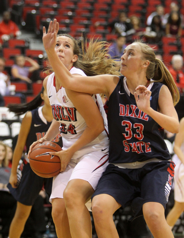UNLV womenճ basketball senior forward Alana Cesarz (24) looks to shoot in front of Dixie State center Taylor Mann in the second half of an exhibition game at the Cox Pavilion Monday, Nov. 10 ...