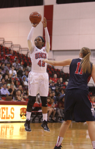 UNLV womenճ basketball senior guard Danielle Miller (42) shoots over Dixie State forward Brianna Jessop in the first half of an exhibition game at the Cox Pavilion Monday, Nov. 10, 2014. (K. ...