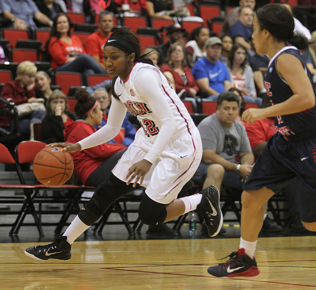 UNLV womenճ basketball senior guard Danielle Miller (42) drives past Dixie State guard Leslie Tademy in the first half of an exhibition game at the Cox Pavilion Monday, Nov. 10, 2014. (K.M.  ...