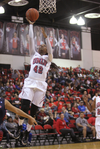 UNLV womenճ basketball senior guard Danielle Miller (42) goes up for a shot against Dixie State during the first half of an exhibition game at the Cox Pavilion Monday, Nov. 10, 2014. (K.M. C ...