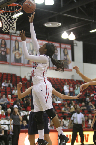 UNLV womenճ basketball senior guard Danielle Miller (42) goes up for a shot against Dixie State during the second half of an exhibition game at the Cox Pavilion Monday, Nov. 10, 2014. (K.M.  ...
