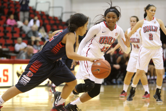 UNLV womenճ basketball senior guard Danielle Miller (42) covers Dixie State guard Leslie Tademy in the second half of an exhibition game at the Cox Pavilion Monday, Nov. 10, 2014. (K.M. Cann ...