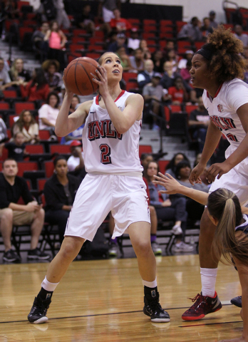 UNLV womenճ basketball freshman guard Brooke Johnson (2) against Dixie State as center Amie Callaway (0) looks on the first half of an exhibition game at the Cox Pavilion Monday, Nov. 10, 20 ...