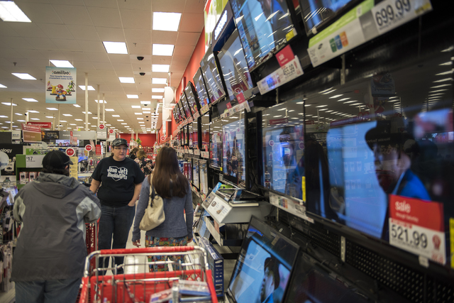 Shoppers (names not given) peruse around Target on 605 N. Stephanie St. in Henderson, Nev., looking for the best Black Friday deals on Friday Nov. 28, 2014. (Martin S. Fuentes/Las Vegas Review-Jou ...