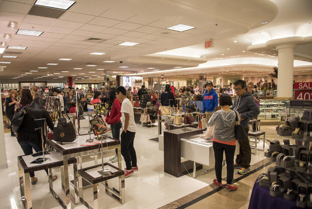 Shoppers (names not given) peruse around Dillard's inside the Galleria at Sunset mall in Henderson, Nev., looking for the best Black Friday deals on Friday Nov. 28, 2014. (Martin S. Fuentes/Las Ve ...