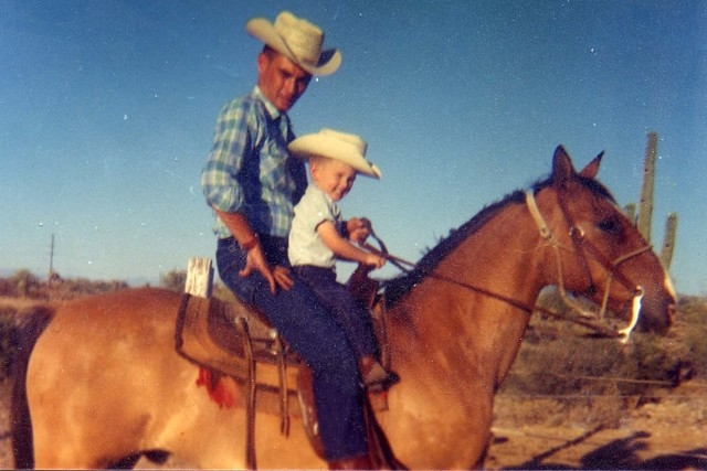 In a photo from September 1964, Gordon Young rides a horse with his son Robert, 3, in Arizona. Gordon was killed about two months later when Bonanza Airlines Flight 114 crashed into a mountain sou ...