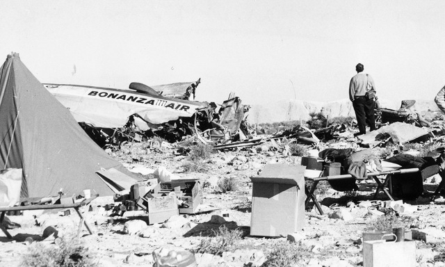 A man stands among the wreckage of Bonanza Air Lines Flight 114, which plowed into mountain just south of Las Vegas on Nov. 15, 1964, killing all 29 people on board. The crash was initially blamed ...