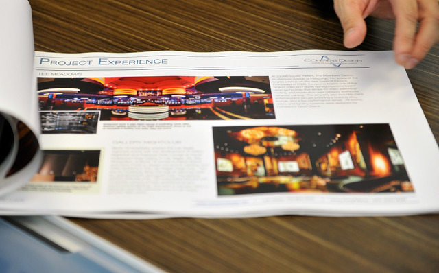 Coherent Design principle Kevin Potts thumbs through his portfolio of work in his Las Vegas office on Friday, Oct. 10, 2014. (David Becker/Las Vegas Review-Journal)