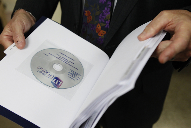 Kenneth Campbell, CEO of Ligation Services, shows a digital copy produced by his team from litigation documents at the Ligation Services offices, 3770 Howard Hughes Parkway, suite 300, in Las Vega ...