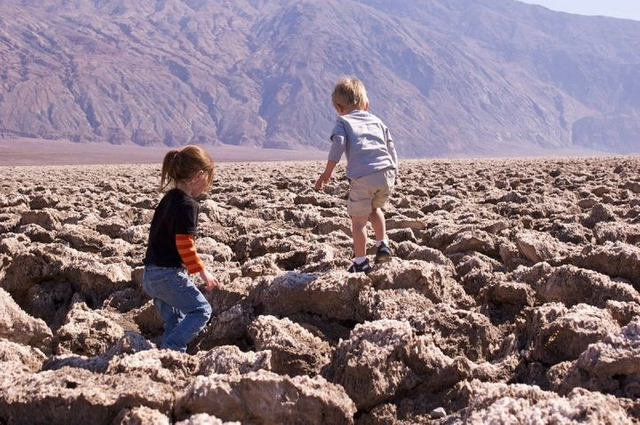 Children explore the surreal landscape of Devil's Golf Course at Death Valley National Park. (Courtesy photo)